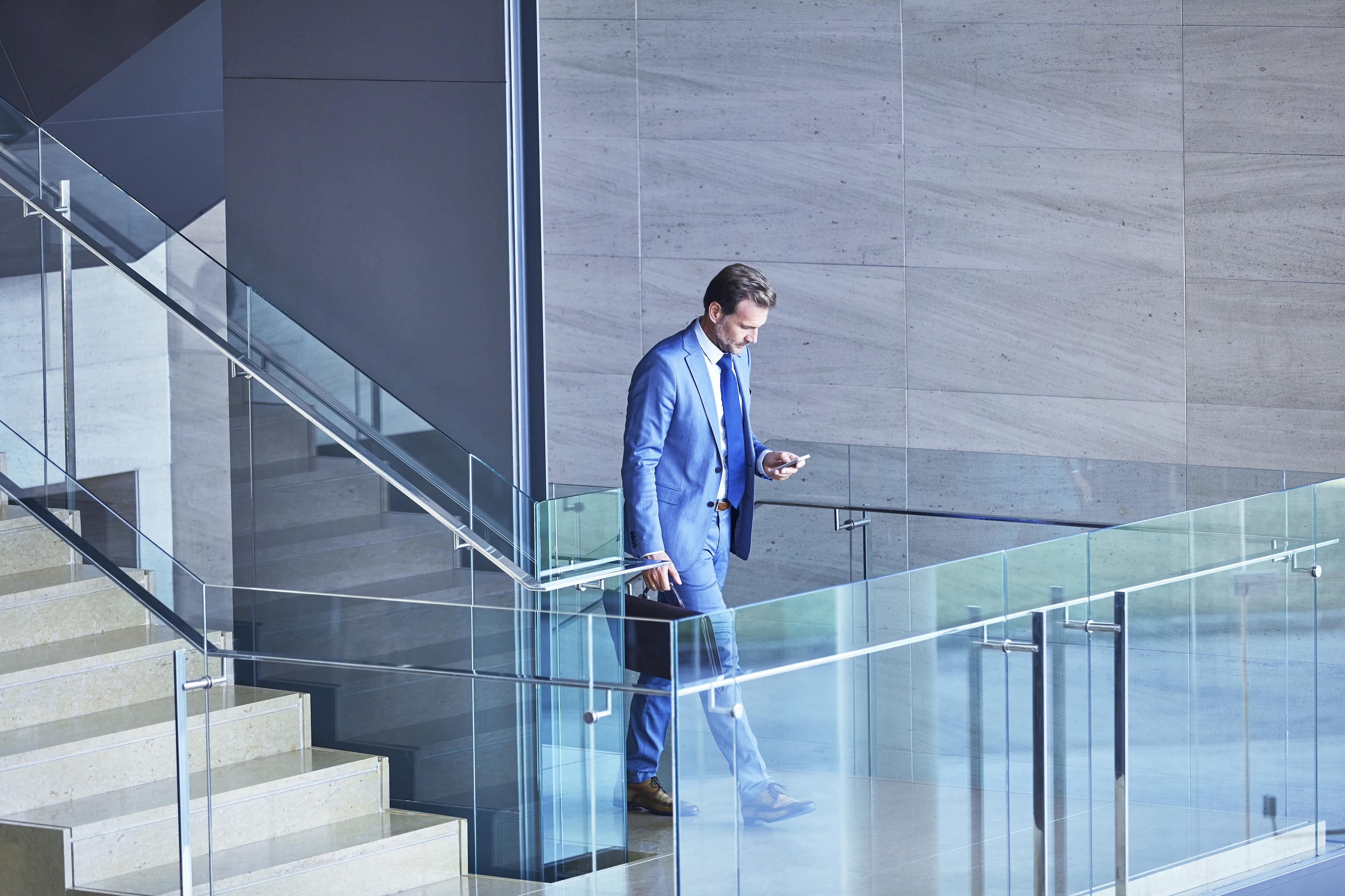 JW_man_blue_suit_walking_phone_RGB_150